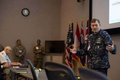 Navy Adm. Michael S. Rogers, who commands U.S. Cyber Command and also directs the National Security Agency and serves as chief of the Central Security Service, speaks to exercise Cyber Guard 2016 visitors in Suffolk, Va., June 16, 2016. Photo was edited for security considerations. Navy photo by Petty Officer 2nd Class Jesse Hyatt