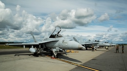 A U.S. Marine Corps F/A-18C Hornet aircraft with Marine Fighter Attack Squadron (VMFA) 314, stationed at Marine Corps Air Station Miramar, California, is parked after it's mission at Eielson Air Force Base, Alaska, during its participation in Red Flag-Alaska 16-2, June 7, 2016. Red Flag-Alaska 16-2 provides squadrons the opportunity to train with joint and international units, increasing their combat skills by participating in simulated combat situations in a realistic threat environment.