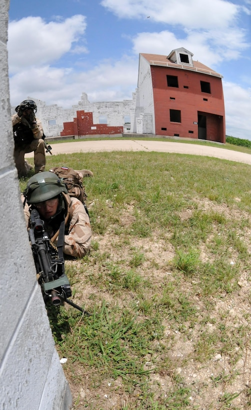 FORT HOOD, TEXAS – A task force of Dutch Soldiers with the 302nd Royal Netherlands Aviation Squadron trekked across rugged terrain and through an ever-changing climate during training exercises held mid-May at Fort Hood, Texas. The Dutch Soldiers were given a plethora of different missions to accomplish throughout the exercise including establishing a command post, conducting night operations, providing fire support, evacuating casualties, and interacting with the local populace in helping solve local issues.The exercise consisted of primarily Dutch forces however U.S. Soldiers and civilians provided support and aided in the role-play of opposing forces to make the event more realistic