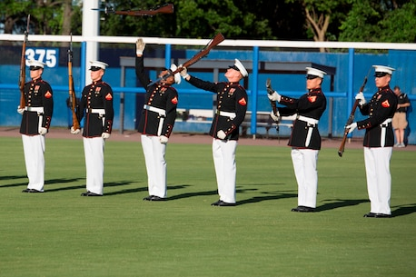 NORFOLK, Va. – The United States Marine Corps Silent Drill Platoon performs during pregame activities of the Norfolk Tides' Marine Night, June 18. The silent drill platoon is stationed in Washington D.C., and travels the country performing at various events. Marine Night was held in honor of the brave men and women who have served, are currently serving in the Marine Corps and those who paid the ultimate sacrifice.  (U.S. Marine Corps photo by Cpl. Logan Snyder)