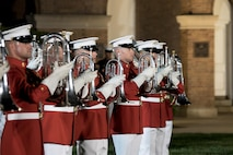 The United States Marine Drum and Bugle Corps performs during the Friday Evening Parade at Marine Barracks Washington, D.C., Jun. 17, 2016. The guest of honor for the parade was the Gen. Mark A. Welsh III, chief of staff of the United States Air Force, and the hosting official was Gen. Robert B. Neller, commandant of the Marine Corps. (Official Marine Corps photo by Staff Sgt. Michael Coleman/Released)