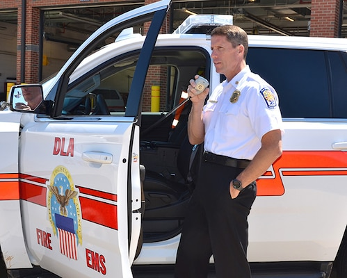 Don Rodgers, Defense Logistics Agency Installation Support at Richmond, Virginia's fire chief, responds to a radio call June 20, 2016 on Defense Supply Center Richmond.