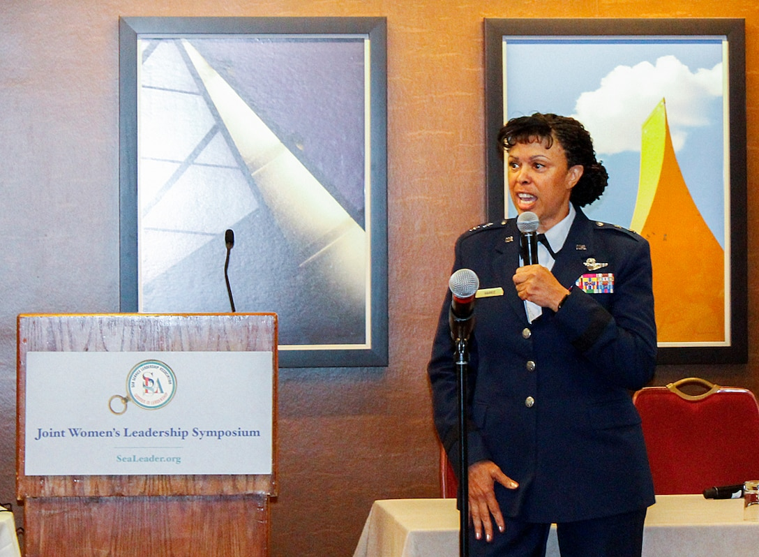 """Maj. Gen. Stayce Harris, 22nd Air Force commander and Command Chief Master Sgt. Ericka Kelly, Air Force Reserve Command, speak to more than 70 women during the 29th Annual Joint Women's Leadership Symposium, in Crystal City, Arlington, Virginia, June 15, 2016. Harris discussed strategies on overcoming challenges impacting women in the military and listened to feedback. The symposium, themed """"Leading with Purpose! Embracing our Future,"""" is considered a unique professional development and networking opportunity. (U.S. Air Force photo/Lt. Col. Denise Kerr)"""