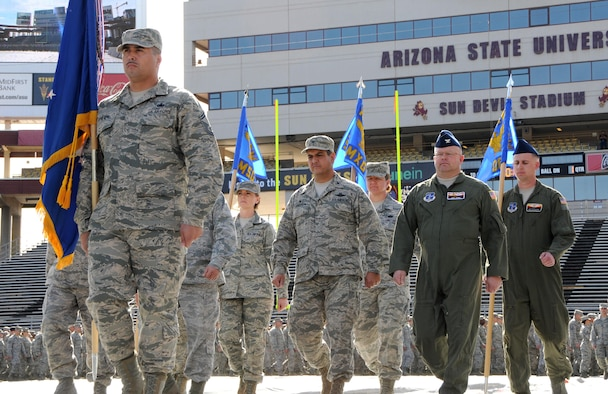 Senior Master Sgt. Alex Brown, front, leads the Arizona Air National Guard's 161st Air Refueling Wing during a march at Sun Devil Stadium in Tempe, Ariz., Dec. 7, 2014. Brown's prior experience as military training instructor made him the unit's resident expert on drill and ceremonies and gave him skills that, he said, helped him graduate from law school. Brown recently passed the Arizona bar exam and fulfilled a personal dream to become an attorney. (U.S. Air National Guard photo/Tech. Sgt. Courtney Enos)