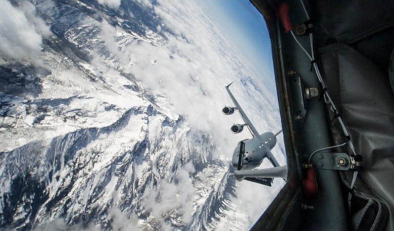Lt. Col. Chad Marchesseault, 92nd Operations Group deputy commander, flew a KC-135 Stratotanker from Fairchild Air Force Base during an air-refueling exercise over Washington State April 5, 2016. One of the receivers, a C-17 Globemaster hailing from Joint Base Lewis-McChord, Washington, was flown by Chad's youngest brother, Capt. Lance Marchesseault, 62nd Operations Support Squadron airlift director. (U.S. Air Force photo/Airman 1st Class Sean Campbell)