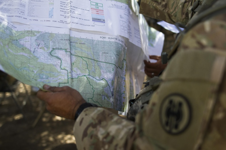 Soldiers from the 341st Military Police Company, of Mountain View, California, use a map to prepare for a simulated mission during the Combat Support Training Exercise (CSTX) at Fort Hunter-Liggett, California, on 18 June. 54 units from across the U.S. Army Reserve, National Guard, Active Army, U.S. Air Force, U.S. Navy, and Canadian Army participate in the 84th CSTX of the year, CSTX 91-16-02, hosted by the 91st Training Division. (Photos by Spc. Victoria Friend)