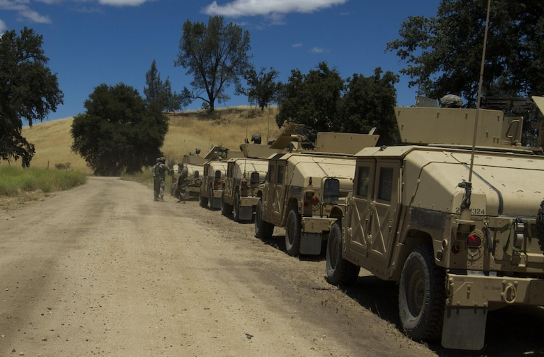 Soldiers from the 341st Military Police Company, of Mountain View, California, prepare to conduct a simulated mission during the Combat Support Training Exercise (CSTX) at Fort Hunter-Liggett, California, on 17 June. 54 units from across the U.S. Army Reserve, National Guard, Active Army, U.S. Air Force, U.S. Navy, and Canadian Army participate in the 84th CSTX of the year, CSTX 91-16-02, hosted by the 91st Training Division. (Photos by Spc. Victoria Friend)