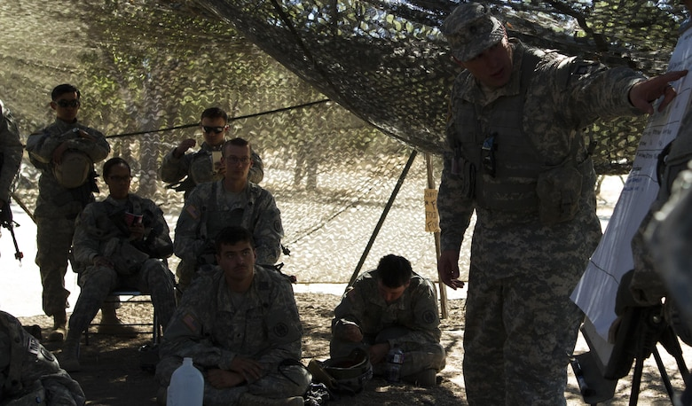 Soldiers from the 341st Military Police Company, of  Mountain View, California, receive feed back and conduct an after action review after returning from a training mission during Combat Support Training Exercise (CSTX) at Fort Hunter-Liggett, California, on 17 June. 54 units from across the U.S. Army Reserve, National Guard, Active Army, U.S. Air Force, U.S. Navy, and Canadian Army participate in the 84th CSTX of the year, CSTX 91-16-02, hosted by the 91st Training Division. (Photos by Spc. Victoria Friend)