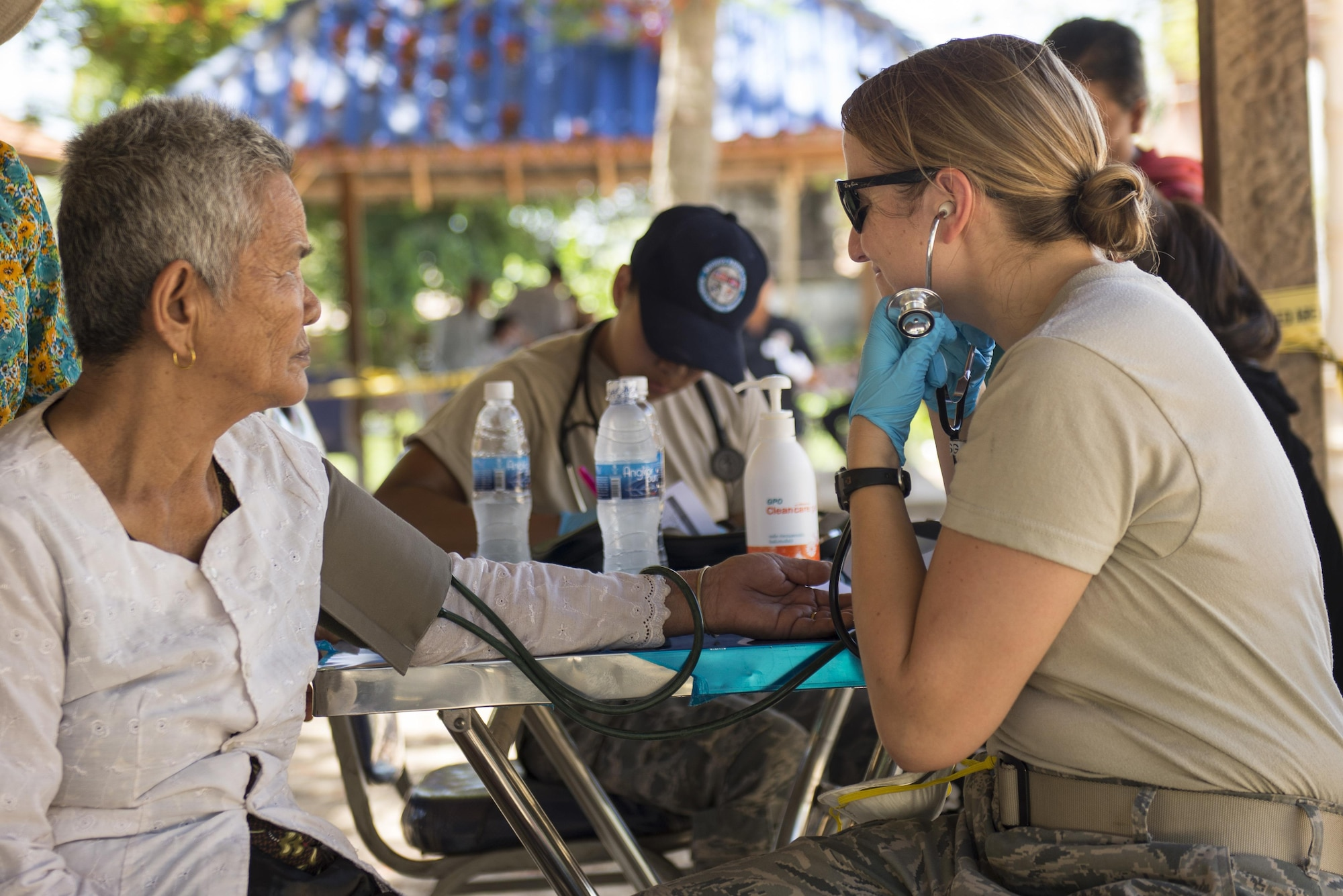 U.S. Air Force TSgt. Nicole Olive, Idaho Air National Guard's 124th Fighter Wing medical technician, listens to the heartbeat of patient during Pacific Angel 16-2, June 13, 2016, in Kampot Province, Cambodia.  The Idaho National Guard has partnered with Cambodia's Armed Forces to train together through the Air National Guard's State Partnership Program. The program is designed to provide a consistent, enduring, and genuine presence, built over time through professional, personal, and institutional relationships that span continents and decades. (U.S. Air Force photo by Senior Airman Omari Bernard/Released)