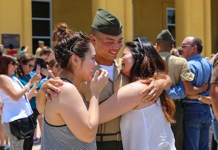 A Marine from Bravo Company, 1st Recruit Training Battalion, hugs his loved ones after being released for liberty at Marine Corps Recruit Depot San Diego, June 16. This is the first time they have seen their Marines since they arrived at the depot 13 weeks ago. Annually, more than 17,000 males recruited from the Western Recruiting Region are trained at MCRD San Diego. Bravo Company is scheduled to graduate June 17.