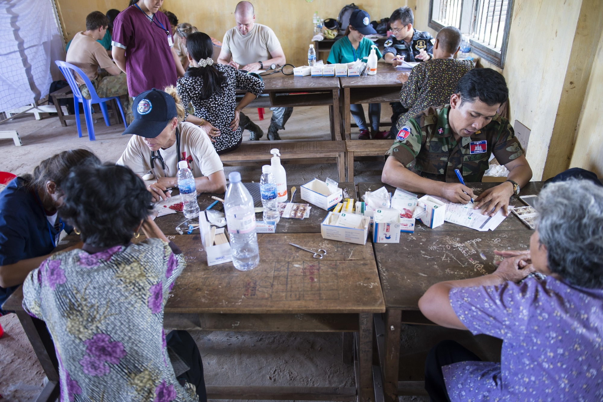 Royal Cambodian Armed Forces medical professionals work as a team alongside U.S. Armed Forces medical professionals to provide care to patients during Pacific Angel 16-2, June 14, 2016, in Kampot Province, Cambodia. The Pacific Angel 16-2 medical team is made up of military health practitioners from the Cambodia Armed Forces, U.S. Armed Forces, Thai Royal Air Force, Australian Royal Air Force and Vietnamese Royal Air Force. Non-governmental organizations such as Project Hope and East Meets West also helped by supplying translators and medics as well.  The U.S. military seeks opportunities to strengthen its relationship with other nations' militaries through activities such as subject-matter expert exchanges, host nation visits, and bilateral engagements. (U.S. Air Force photo by Senior Airman Omari Bernard/released)