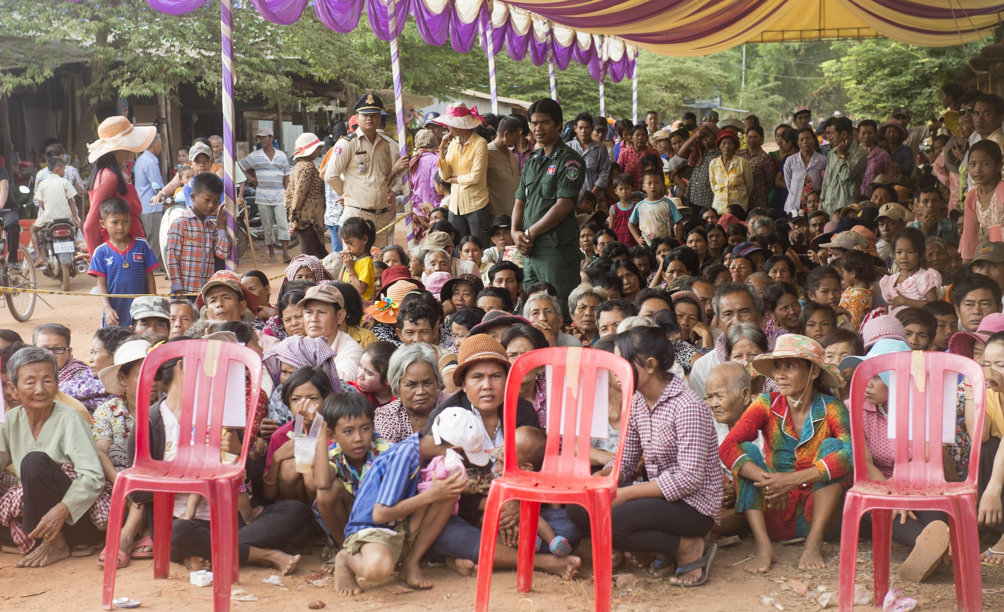 People from surrounding villages in Kampot Province wait patiently outside of a medical site to be seen during Pacific Angel 16-2, June 15, 2016, in Kampot Province, Cambodia. During Pacific Angel 16-2 the multilateral Pacific Angel medical team of providers saw more 1,500 patients within the first three days of the humanitarian mission. Pacific Angel ensures that the region's militaries are prepared to work together to address humanitarian crises in case of natural disasters. (U.S. Air Force photo by Senior Airman Omari Bernard/released)