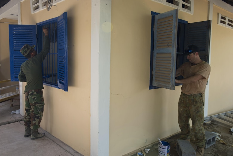 Royal Cambodian Armed Forces Sgt. Ngin Samnang, Royal Cambodian Army engineer,  works alongside Royal Australian Air Force Lead Aircraftsman Anthonly Holmes, 65th Squadron engineer; Townsville, Australia,  to paint the shudders of a health center during Pacific Angel 16-2 June 15, 2016, in Kampot Province, Cambodia. Pacific Angel is a humanitarian assistance/civil military operation mission that builds partner capacity through medical/health outreach, engineering civic projects and subject matter exchanges. The U.S. military is always seeking opportunities to strengthen its relationship with other nations' militaries through activities and engagements such as Pacific Angel. (U.S. Air Force photo by Senior Airman Omari Bernard/Released)