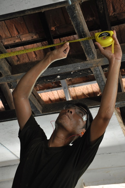 Royal Cambodian Air Force Sgt. Gnin Samnang repairs roofing at the Toukmeas Provincial Health Center June 15, 2016, during Pacific Angel 16-2 in Kampot Province, Cambodia. The Pacific Angel multinational engineer team provided humanitarian aid to the local community while training together and improving each other's skills. Missions such as Pacific Angel are critical to advancing partner nation's abilities to operate together while preserving peace and stability in the region. (U.S. Air Force photo by Capt. Susan Harrington/Released)