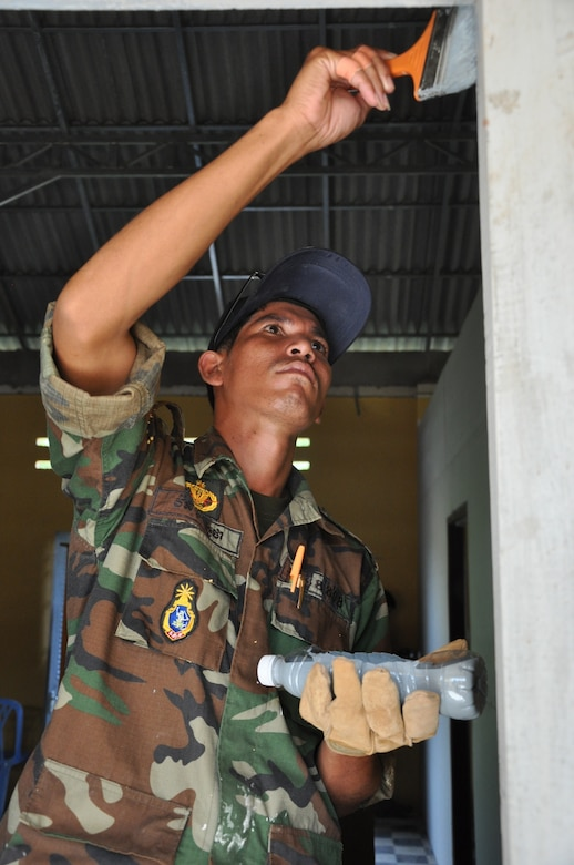 Royal Cambodian Armed Forces Sgt. Vorn Rotha, a civil engineer, paints a room in the Meas Sophea Baneav Health Center June 16, 2016 as part of Pacific Angel 16-2 in Kampot Province, Cambodia. The Pacific Angel engineer team is a multinational group of engineers from Royal Cambodian Armed Forces, U.S. Department of Defense, and the Royal Australian Air Force. Engagements such as Pacific Angel promote interoperability with our partner nations, ensuring that the region's militaries are prepared to work together to address humanitarian crises. (U.S. Air Force photo by Capt. Susan Harrington/Released)