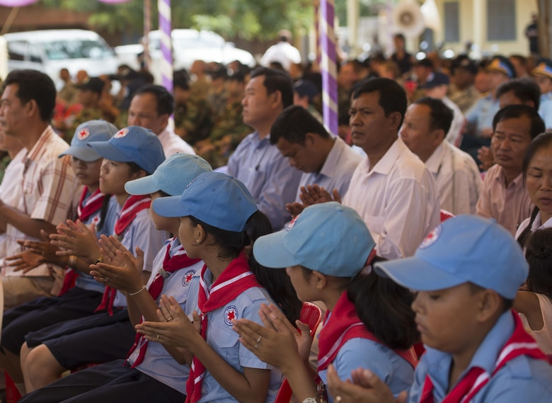 Residents of Kampot Province, Cambodia, and members of the Pacific Angel Team attend the Pacific Angel 16-2 closing ceremony at Wat Steung Primary School June 20, 2016, in Kampot Province, Cambodia. Pacific Angel 16-2 is a humanitarian assistance/civil military operation mission designed to foster relations and partnerships between the U.S., Cambodia and several other partner nations through subject matter expert exchanges, medical aid and civil engineering projects. (U.S. Air Force photo by Senior Airman Omari Bernard/Released)