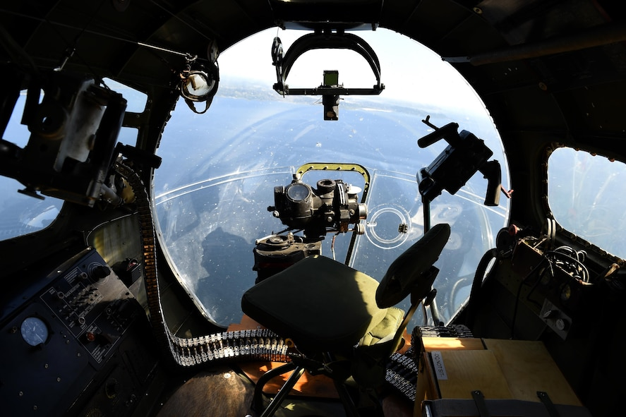 The nose turret of a B-17 Flying Fortress flying over Seattle, Wash., June 6, 2016. The navigator and bombardier were both located in the nose turret. (U.S Air Force photo/ Tech. Sgt. Tim Chacon)