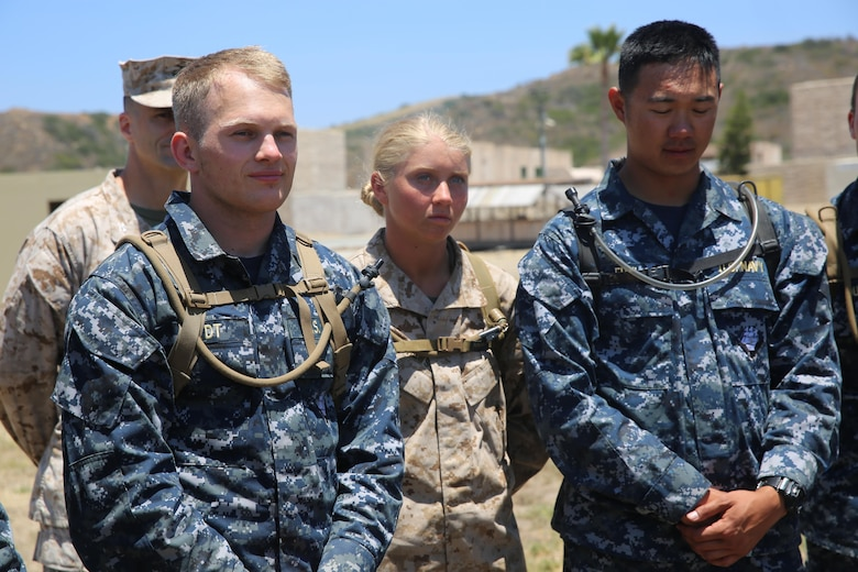 MARINE CORPS BASE CAMP PENDLETON, Calif. - Michelle Mathews, (center), and her fellow Midshipmen stand at ease while waiting for further instruction on the next phase of their training evolution of the Career Orientation and Training of Midshipmen program at Camp Pendleton June 16, 2016. Mathews runs track and plays volley ball for Villanova University in order to keep her physical fitness at a high level and relieve stress. The program allows college students, like Mathews, to familiarize themselves with some of the Marine Corps and Navy military operations and tactics without disrupting their education. (U.S. Marine Corps Photo by Cpl. Demetrius Morgan/RELEASED)
