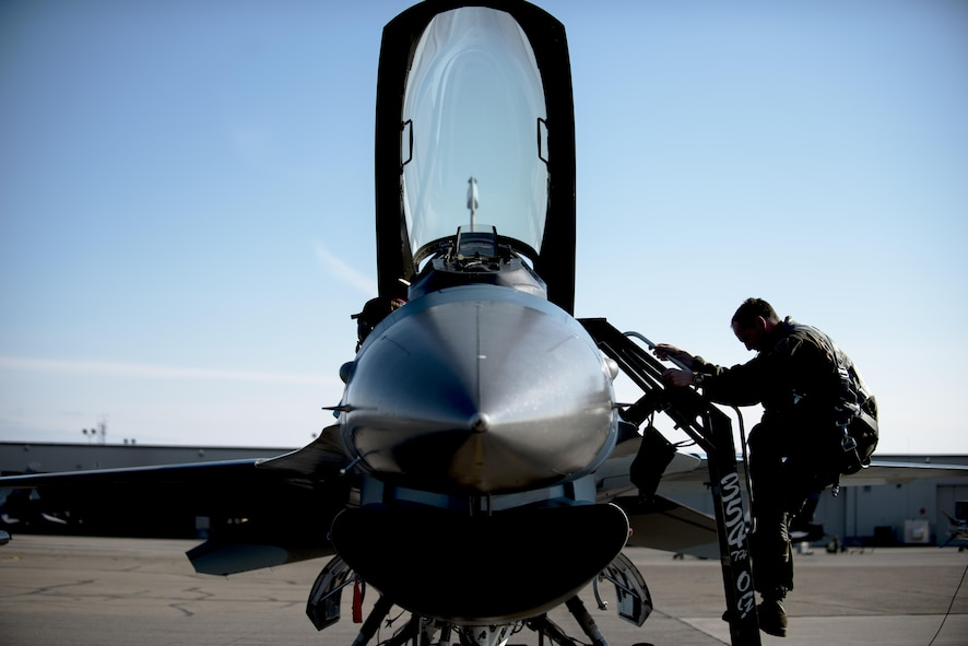U.S. Air Force Col. Brian Toth, the 354th Operations Group commander, climbs an F-16 Fighting Falcon before a morning sortie, June 16, 2016, during RED FLAG-Alaska 16-2, at Eielson Air Force Base, Alaska. Toth took command in July 2015, making this his third assignment at Eielson. (U.S. Air Force photo by Staff Sgt. Ashley Nicole Taylor/Released)