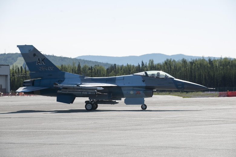 U.S. Air Force Col. Brian Toth, the 354th Operations Group commander, taxis for a morning sortie June 16, 2016, during RED FLAG-Alaska 16-2, at Eielson Air Force Base, Alaska. Toth took command last July and logged more than 200 hours in the F-16. (U.S. Air Force photo by Staff Sgt. Ashley Nicole Taylor/Released)