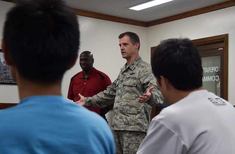 U.S. Air Force Col. William Bowman, the commander of the 35th Operations Group, speaks with members of the Japan Railway East Akita Peckers basketball team at Misawa Air Base, Japan, June 17, 2016. As part of a Misawa AB tour and basketball camp, the Japanese team was briefed on the purpose and mission of the 35th Fighter Wing. The goal of the event was to promote bilateral relations and help basketball players prepare for the upcoming season. (U.S. Air Force photo by Senior Airman Deana Heitzman)