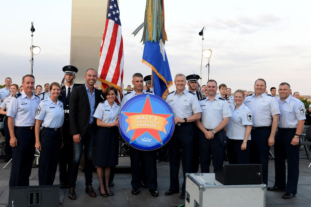 Lt. Gen. Gina M. Grosso, Deputy Chief of Staff for Manpower, Personnel and Services, Headquarters U.S. Air Force, accepts the Macy's Day Parade drum head with Band and Honor Guard leadership at the Air Force Memorial in Arlington, Va., June 17, 2016. During the performance, the Macy's Band Selection Committee announced the United States Air Force Band and Honor Guard will represent the Air Force and perform in New York City in the 2017 Macy's Thanksgiving Day Parade. (U.S. Air Force photo/Tech. Sgt. Matt Davis)