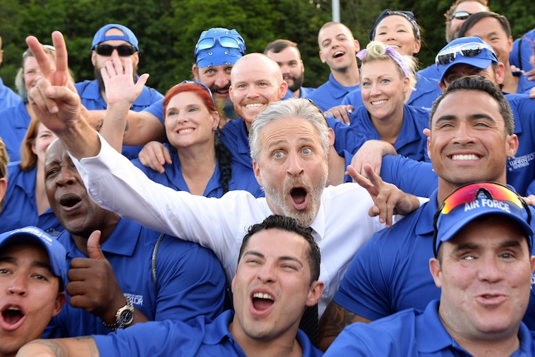 Comedian Jon Stewart, most notably of The Daily Show, poses for a photo with the Air Force team during the 2016 Department of Defense Warrior Games on June 15, 2016. Stewart emceed the opening ceremonies for the games. (Department of Defense photo/EJ Hersom)