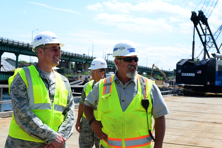 Col. Paul Loiselle, 157th Mission Support Group commander, and Mike Franck, Safety Manager at Cianbro Corporation, review the progress of the Sarah Mildred Long replacement project in Portsmouth, New Hampshire June 16. (Air National Guard Photo by Airman 1st Class Ashlyn J. Correia)
