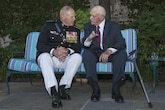 Marine Corps Gen. Robert B. Neller, left, commandant of the Marine Corps, speaks to retired Gunnery Sgt. Gardner Brown, World War II veteran, during the evening parade reception at the Home of the Commandants, Washington, D.C., June 17, 2016. Evening parades are held as a means of honoring senior officials, distinguished citizens and supporters of the Marine Corps.