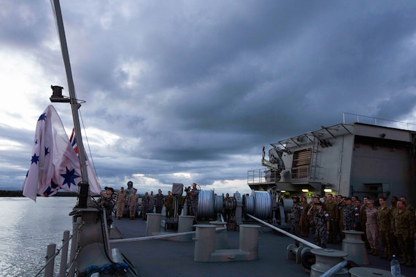 U.S. Marines, Australian soldiers and Australian sailors stand at attention for the lowering of the Australian flag aboard the HMAS Adelaide at Port of Brisbane, Queensland, Australia, June 16, 2016. This marks the first time Marines and sailors from Marine Rotational Force - Darwin have embarked in such numbers on an Australian HMAS. This opportunity allows for MRF-D to expand the partnership capabilities with our Australian allies. The Marines are with 1st Battalion, 1st Marine Regiment, MRF-D.
