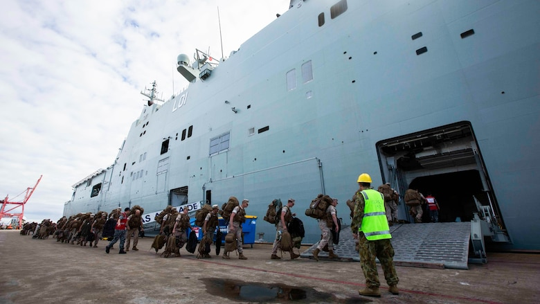 U.S. Marines go aboard the HMAS Adelaide at Port of Brisbane, Queensland, Australia, June 16, 2016. This marks the first time Marines and sailors from Marine Rotational Force - Darwin have embarked in such numbers on an Australian HMAS. This opportunity allows for MRF-D to expand the partnership capabilities with our Australian allies. The Marines are with 1st Battalion, 1st Marine Regiment, MRF-D, and the Australians are with HMAS Adelaide.