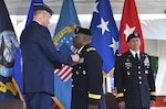 Air Force Lt. Gen. Andy Busch pins the Defense Superior Service Medal on Army Brig. Gen. Richard Dix as Brig. Gen. John Laskodi looks on at the DLA Distribution change of command ceremony in New Cumberland, Pennsylvania, June 17. Dix concluded 24 months as commander of DLA Distribution.