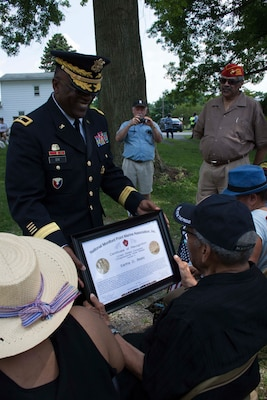 Dix recognized Eartha Beaty, a 90-year-old Montford Point Marine, one of the first African Americans to serve in the United States Marine Corps, with a Certificate of Appreciation from the Montford Point Marine Association.