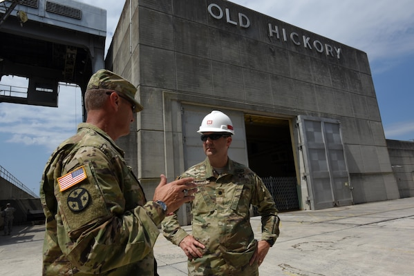 Maj. Gen. Jeffrey H. Holmes, deputy adjutant general for the Tennessee National Guard, and Lt. Col. Stephen Murphy, U.S. Army Corps of Engineers Nashville District commander, confer June 20, 2016 during a security assistance exercise where soldiers set up a perimeter to protect the Old Hickory Dam Power House and switchyard and ensured only authorized personnel gained entry into the facility located in Hendersonville, Tenn.