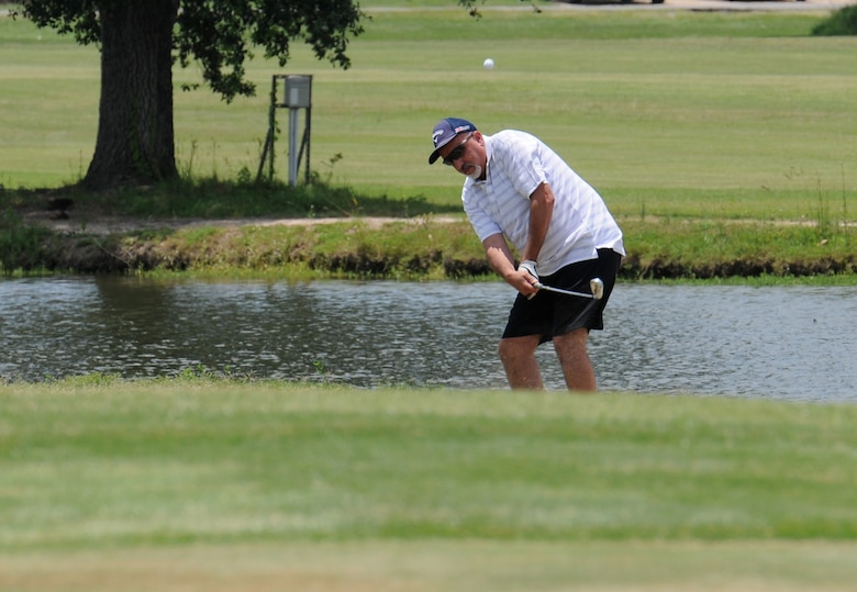 Barry Argento, 403rd Wing comptroller, takes a swing on hole #10 during the Don Wylie Memorial Golf Tournament at the Bay Breeze Golf Course June 17, 2016, Keesler Air Force Base, Miss. The annual tournament raised funds to help the Military & Veterans Affairs committee honor military members.  (U.S. Air Force photo by Kemberly Groue)