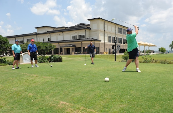 Chris McIntyre, 81st Force Support Squadron deputy commander, tees off during the Don Wylie Memorial Golf Tournament at the Bay Breeze Golf Course June 17, 2016, Keesler Air Force Base, Miss. The annual tournament raised funds to help the Military & Veterans Affairs committee honor military members. (U.S. Air Force photo by Kemberly Groue)