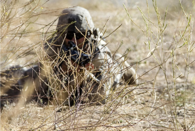 A U.S. Army Reserve Soldier, 1017th Quartermaster Company, Camp Pendleton, Calif.,prepares to react to enemy fire during a tactical scenario as part of Combat Support TrainingExercise 91-16-02, Fort Hunter Liggett, Calif., June 17, 2016. As the largest U.S. Army Reservetraining exercise, CSTX 91-16-02 provides Soldiers with unique opportunities to sharpen theirtechnical and tactical skills in combat-like conditions. (U.S. Army photo by Sgt. Krista L.Rayford, 367th Mobile Public Affairs Detachment)