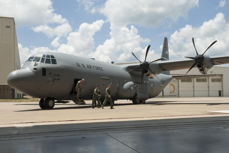 U.S. Air Force Gen. Carlton D. Everhart II, Air Mobility Command commander, departs a C-130J prior to an aircraft delivery ceremony at Little Rock Air Force Base, Ark., June 20, 2016. Everhart delivered the final C-130J to the 19th Airlift Wing form Lockheed Martin. (U.S. Air Force photo/Senior Airman Harry Brexel)