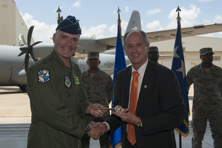 Gary Fletcher, Mayor of Jacksonville, Ark., presents a key to the city to Gen. Carlton D. Everhart II, Air Mobility Command commander, at Little Rock Air Force Base, Ark., June 20, 2016. Everhart visited Little Rock AFB to deliver the final C-130J to the 19th Airlift Wing from Lockheed Martin. (U.S. Air Force photo/Senior Airman Harry Brexel)