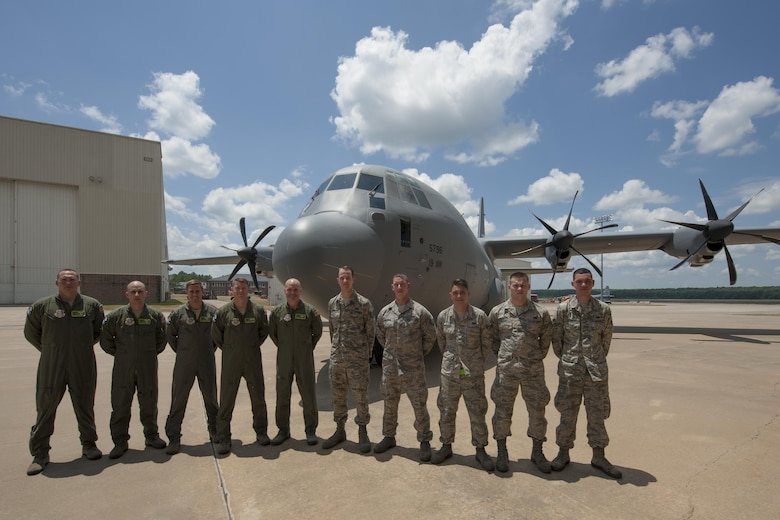U.S. Air Force Gen. Carlton D. Everhart II, Air Mobility Command commander, center, stands with a crew of Airmen who delivered a C-130J to the 19th Airlift Wing at Little Rock Air Force Base, Ark., June 20, 2016. The aircraft was the final C-130J to be delivered from Lockheed Martine and marks the end of an airframe transition that lasted more than a decade at Little Rock AFB.  (U.S. Air Force photo/Senior Airman Harry Brexel)