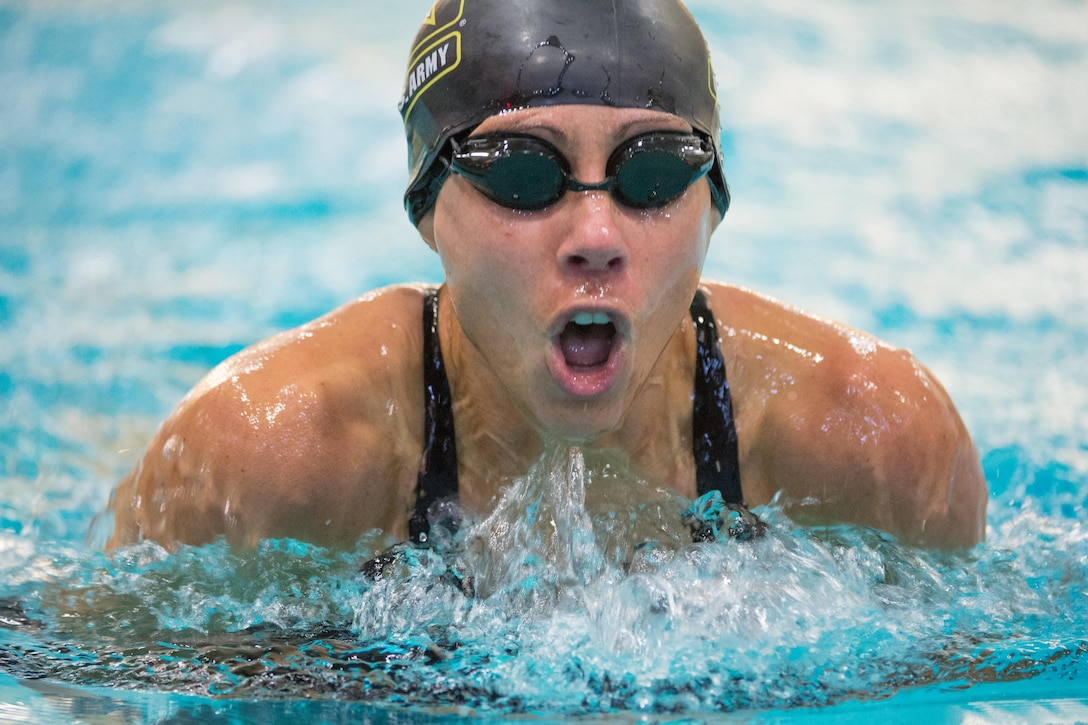 Army Capt. Kelly Elmlinger competes in a breaststroke event