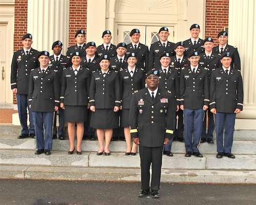 Army Brig. Gen. Richard Dix, DLA Distribution commander, stands with 19 newly-commissioned 2nd lieutenants from the Bison Battalion.