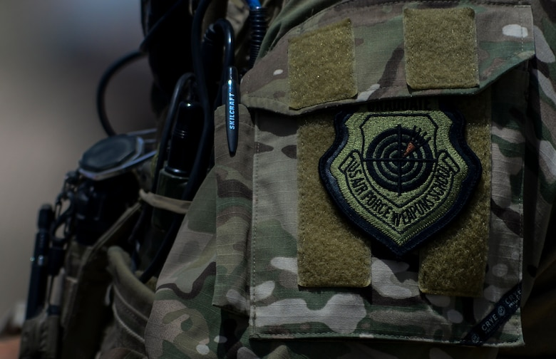 A Joint Terminal Attack Controller wears the covetable United States Weapons School Graduate Patch during Joint Forcible Entry Exercise on the Nevada Test and Training Range, June 16, 2016.  JFEX tests participants' ability to synchronize aircraft movements from geographically-separated bases, command large formations of dissimilar aircraft in high threat airspace, and tactically deliver and recover combat forces via air drops and combat landings on an unimproved landing strip. (U.S. Air Force photo by Airman 1st Class Kevin Tanenbaum)