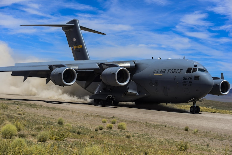 "A C-17 Globemaster III, assigned to the 17th Weapons Squadron, Nellis Air Force Base, Nevada, lands on an airstrip in the Nevada Test and Training Range during Joint Forcible Entry Exercise, June 16, 2016. JFEX is meant to be a challenge for aircrews and ground combat units involved, it's just as much an evaluation of the mission leadership's ability to efficiently integrate ground forces and dissimilar aircraft into one ""strike package.""  (U.S. Air Force photo by Airman 1st Class Kevin Tanenbaum)"
