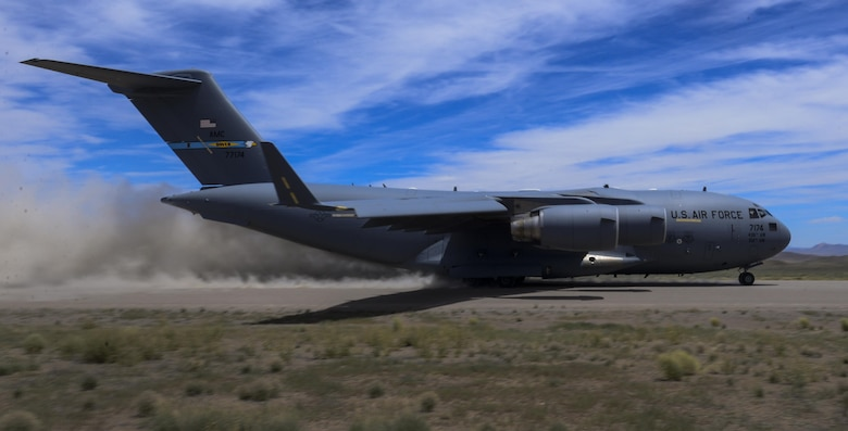 A C-17 Globemaster III, assigned to the 17th Weapons Squadron, Nellis Air Force Base, Nevada, lands on an airstrip in the Nevada Test and Training Range during Joint Forcible Entry Exercise, June 16, 2016. During the Joint Forcible Entry exercise, pilots' flying skill and decision making was tested in the execution of various missions in a contested environment. (U.S. Air Force photo by Airman 1st Class Kevin Tanenbaum)