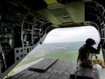 A reservist looks out over Central Pa. during an early morning Chinook flight from New Cumberland to Fort Indiantown Gap as part of a Reserve training mission.
