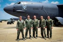 A B-52 stratofortress crew poses for a photo after a B-52 and B-1 Lancer integration flight at Barksdale Air Force Base, La., June 15, 2016. Capt. Dane Kidman, far left, a B-1 Lancer navigator from Dyess Air Force Base, Texas, joined the B-52 crew from Barksdale for the flight. The intent of the flight was not only for training, but also to further create a bomber culture under Air Force Global Strike Command. (U.S. Air Force photo/Senior Airman Luke Hill)