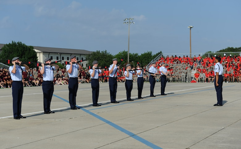 "Members of the 335th Training Squadron freestyle drill team perform during the 81st Training Group drill down at the Levitow Training Support Facility drill pad June 17, 2016, Keesler Air Force Base, Miss. The 335th TRS ""Bulls"" placed first in the freestyle and overall competitions. (U.S. Air Force photo by Kemberly Groue)"