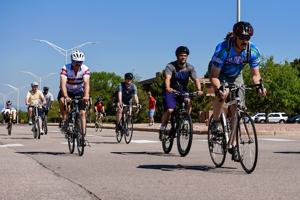 PETERSON AIR FORCE BASE, Colo. – Peterson Airmen take off at the beginning of the 10k bike course during the annual Sports and Field Day at Peterson Air Force Base, Colo., June 16, 2016. Events began at 8 a.m. and were scattered throughout the day, ending at 2 p.m. (U.S. Air Force photo by Senior Airman Rose Gudex)