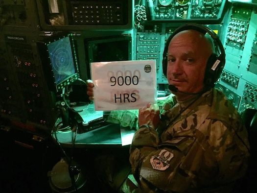 Lt. Col. Barry Cupples, Jr., 328th Airlift Squadron navigator, poses as he surpasses 9,000 flying hours, June 3, 2016. Cupples attained this milestone while deployed in support of Operation Inherent Resolve.